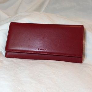 Red leather Coach wallet.